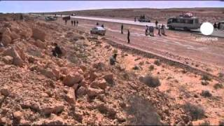 Libyan army attempt to stop rebels pushing west