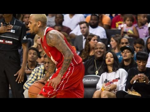 Rihanna Caught Eyeing & Attending Chris Brown's BasketBall Game - Rihanna & Chris Brown Dating?