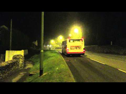 As night-time fog starts to thicken, very musical First Devon & Cornwall Optare Solo 53011 , W811 PAF climbs the steep hill to Townstall Farm House and passes by.