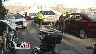 Drivers wait in line to be ticketed for distracted driving