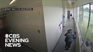 Surveillance video shows Oregon coach disarming and hugging high school student