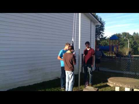 Raising the American Flag at Lifesprings Academy.