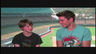 Zac Efron and Charlie Tahan hanging out at Dodgers Stadium discussing 'Charlie St. Cloud'
