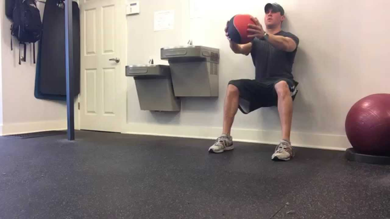 wall sit with medicine ball hold