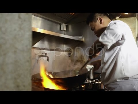 Professional Chef Cooking In Asian Restaurant Kitchen. Stock Footage
