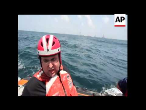The AP's Harry Weber rode with the Coast Guard to the oil rig site and talks about the choppy water