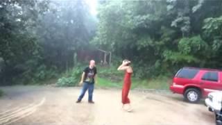 SEXY WOMAN DIRTY DANCING IN THE RAIN!