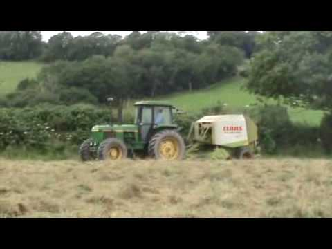 John Deere 4240S Tractor Baling with Claas Rollant