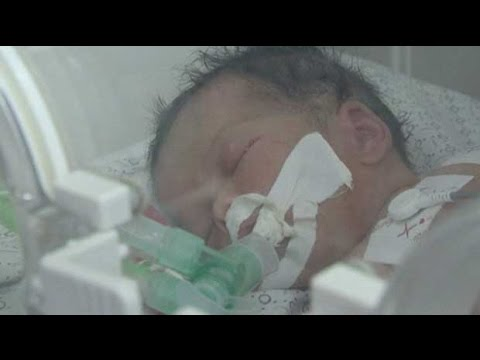 Gaza conflict: baby born after mother killed in airstrike