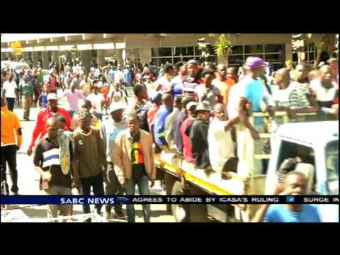 Thousands of Zimbabweans marched in support of Robert Mugabe