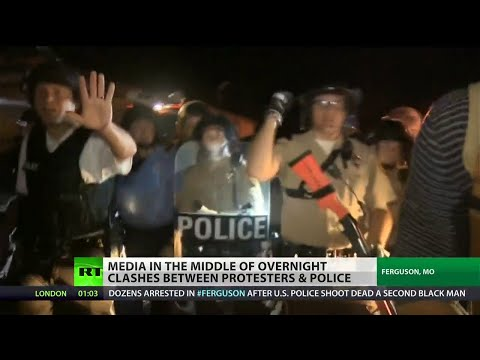 Ferguson cops aim guns at protesters and journalists
