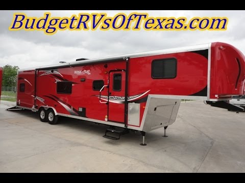 38ft 2014 Work And Play WPF 38 RLS Fifth Wheel Toy Hauler | Ideal For Fun and Comfort!