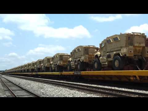 MRAP Military Transport Vehicles ready to be hauled by Train