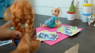 Elsa and anna playing cards. Elsia cheating