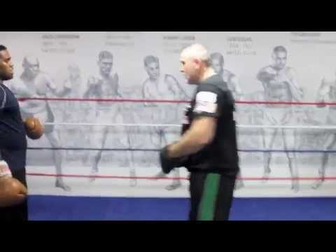 'FAST EDDIE CHAMBERS' WORKS ON THE OVERHAND RIGHT WITH TRAINER PETER FURY / PADWORK