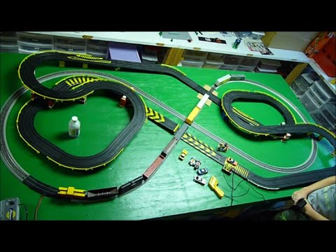HO Slot Cars versus Freight Train on our layout - Crashes at Road & Rail crossing