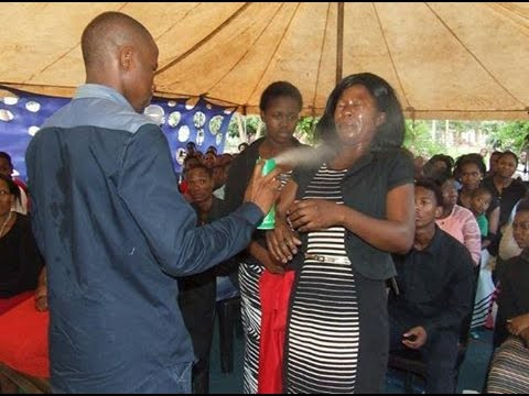 South African Prophet Healing Members With Insecticide Spray