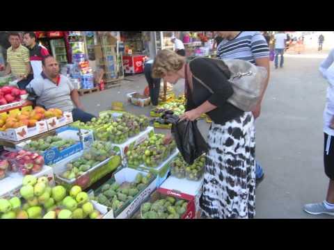 East Jerusalem-  Buying fresh figs in the Arab market near the Damascus Gate, Jerusalem