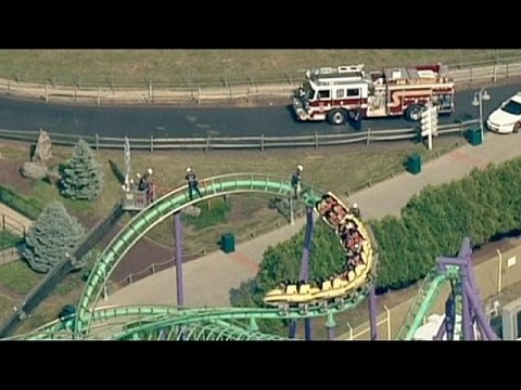 Thrill seekers stranded 45ft mid-air after roller coaster breaks down in Maryland, US