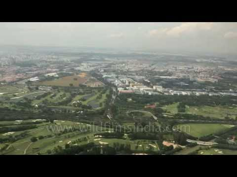 Aerial footage of Kuala Lumpur city and Malacca Strait