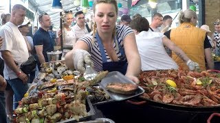 Huge Pans Cooking Huge Doses of Fish.  Kiev Street Food, Ukraine