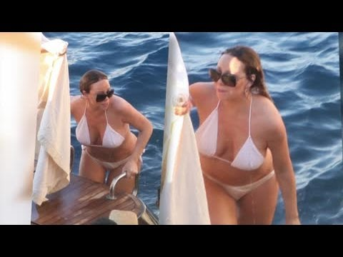 Mariah Carey Shows Off Her Curves in a Barely-There White Bikini - Splash News