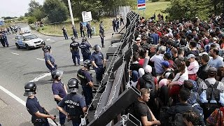 Refugees massed on Serbian border face long walk into Europe
