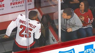 Fans get the boot after harassing Smith-Pelly in penalty box