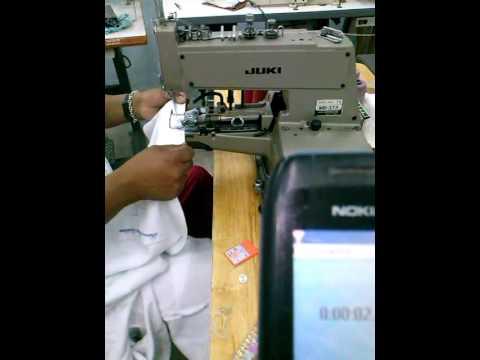 Pega de un boton en mquina industrial