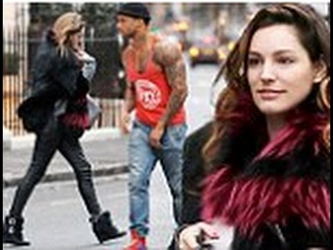Kelly Brook spotted stepping out with ex-Gladiators hunk David McIntosh outside her home