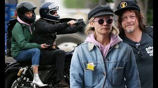 Diane Kruger hops on the back of Norman Reedus' motorcycle