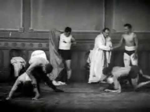 Old time dudes strip down and start wrestling, crazy tough guys.