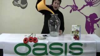 Como colocar flores en un recipiente de cristal. Técnica