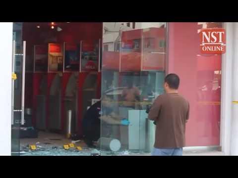 Five men blast open two ATM machines in Putatan, escape with cash