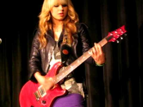 Orianthi playing some solos at Mix 94.7 in Austin