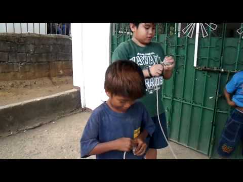 little filipino boys & spinning tops
