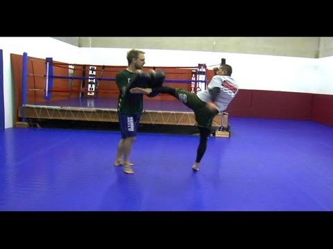 Basic Muay Thai Pad Drill: Shield and Kick Return Image 1