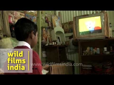 Assamese boy gets ready for school, starts day with television!