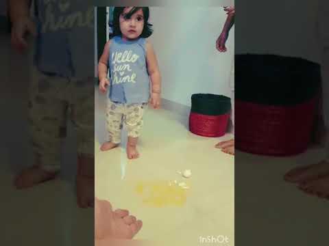 Baby Bella breaks an egg. :)