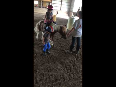 August 2014 Isabella and Ava Riding Horses