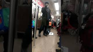 Singing on the NYC  A train for change 12/14/18