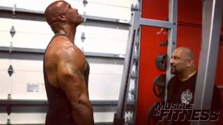The Rock shrugs 315lbs for 25 reps/3 sets!
