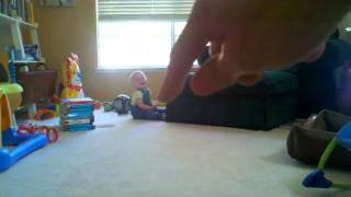 Baby Being Tickled by the Giant Hand