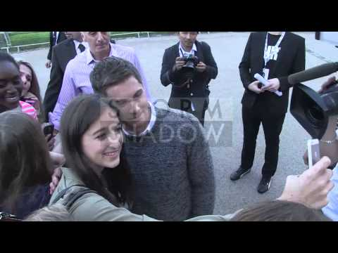 Logan Lerman greets fans at Fury Photocall in Paris