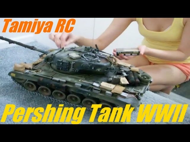 She is weathering a 1:16 Scale TAMIYA RC Tank - WWII Pershing Tank