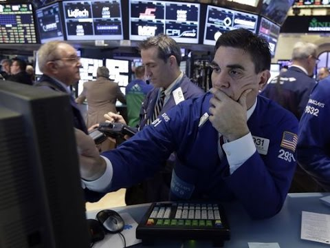 Stocks close lower as Fed ends bond buying