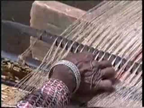 Weaving with a backstrap loom in the Himalayas - 1993