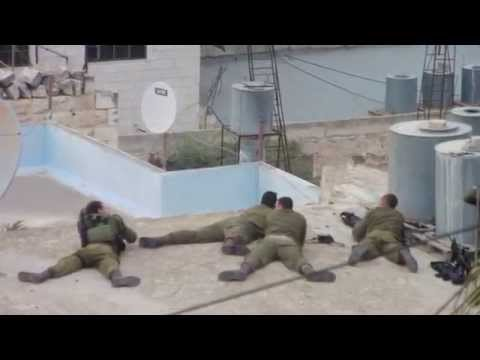 Israeli soldiers celebrate shooting a Palestinian youth