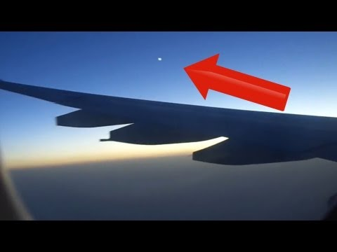 Latest UFO Sightings UFO Captured Following Plane