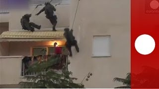 video Anti-terrorist commandos rappelled down a building to rescue a four-year-old girl from her uncle on December 4. The man had barricaded himself inside the girl's parents' house. After two hours...